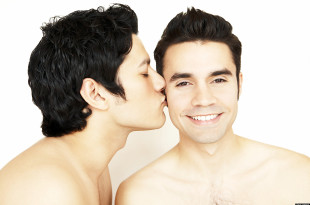 Shirtless gay couple kissing